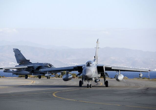 Two British Tornados taxi on the runway, after returning from a mission, at RAF Akrotiri in southern Cyprus December 3, 2015