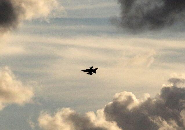 A British Tornado jet flies above RAF Akrotiri, a peninsula on the southern coast of Cyprus where Britain retains a military air base, Cyprus December 2, 2015