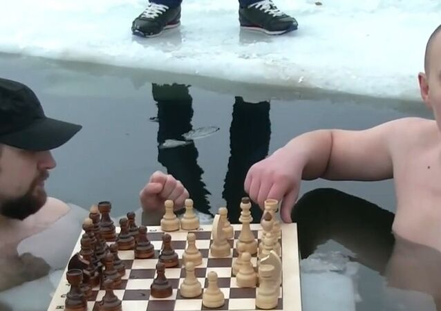 Russia: Watch as swimmers play chess in frozen lake near Yekaterinburg