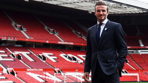 Former Manchester United and England footballer David Beckham poses on the pitch at Old Trafford in Manchester, north west England on October 6, 2015 ahead of a charity football match in aid of UNICEF - Sputnik International