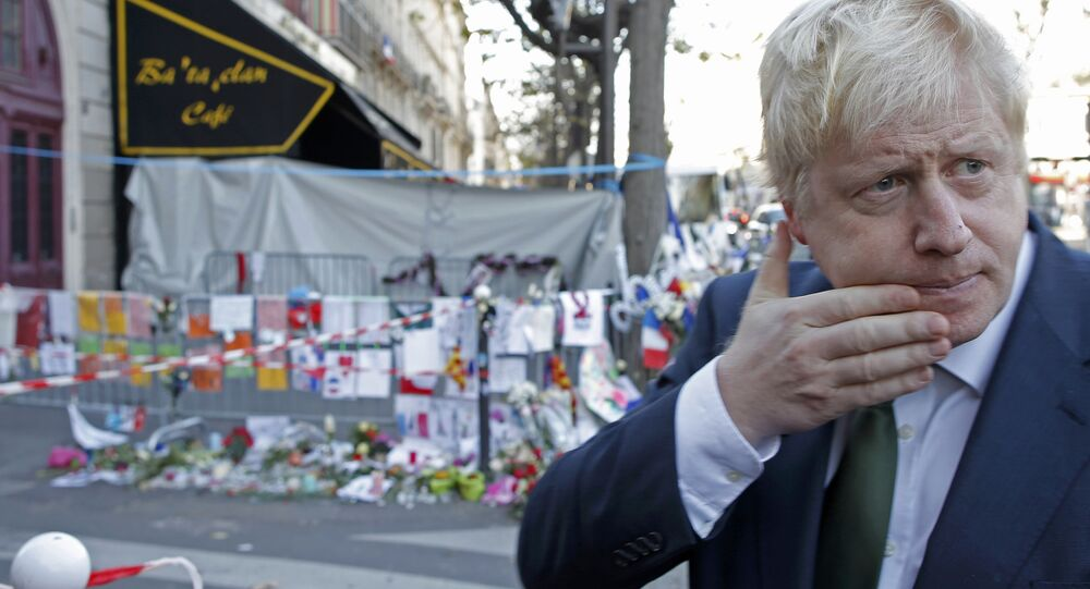 London Mayor Boris Johnson leaves after placing flowers at the Bataclan concert hall to pay tribute to the shooting victims in Paris, France, December 3, 2015.