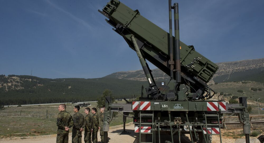 German soldiers stand to attention in front of a German Patriot missile launcher at the Gazi barracks in Kahramanmaras, southern Turkey on March 25, 2014
