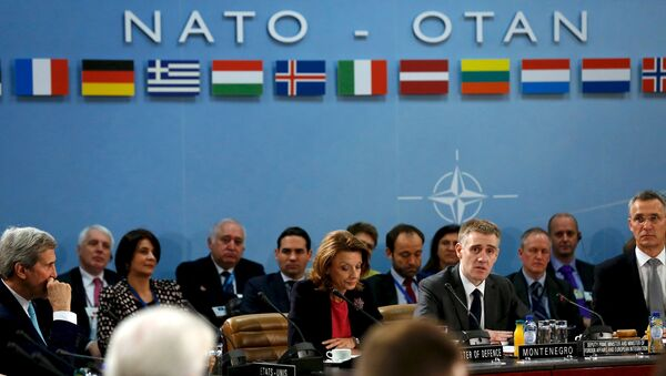 Montenegro's Foreign Minister Igor Luksic (at table, 2nd R) delivers remarks with Defense Minister Milica Pejanovic (3rd R) after Montenegro was welcomed as a new member at the NATO ministerial meetings at the NATO headquarters in Brussels December 2, 2015 - Sputnik International