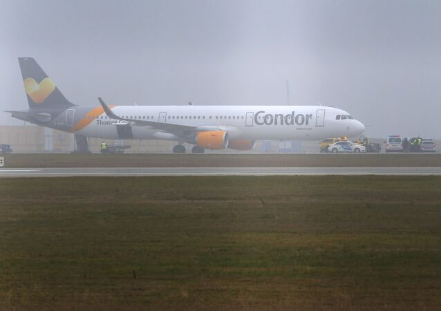 A Condor airlines Airbus A321 stands on the tarmac at the airport in Budapest, Hungary