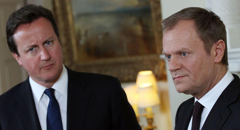 Britain's Prime Minister David Cameron, left, listens to European Council President Donald Tusk.