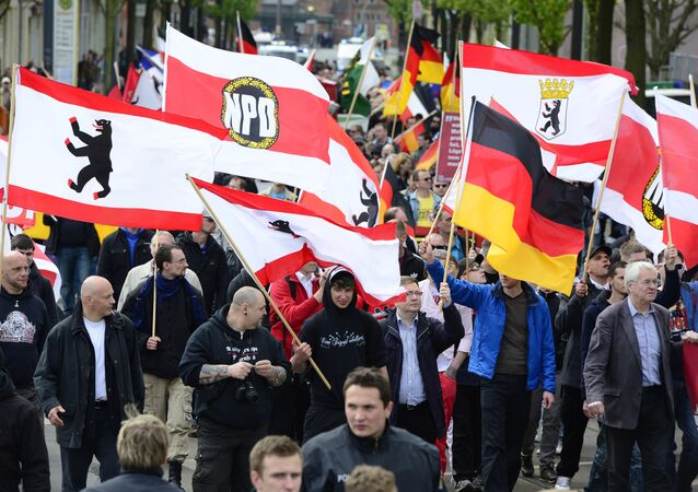 Supporters of Germany's right-extremist National Democratic Party (NPD) wave flags as they take part in a Neo-Nazi demonstration in Berlin.