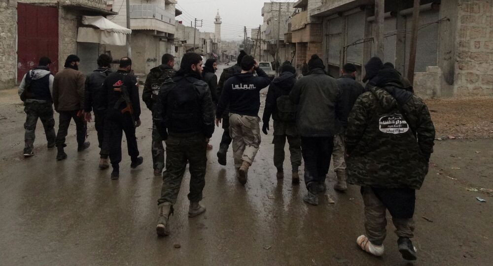 Opposition fighters from the Ahrar Al-Sham brigade, part of the Islamic front coalition, walk in the Shiekh Lutfi neighbourhood of the northern Syrian city of Aleppo during ongoing clashes with government forces on January 27, 2014