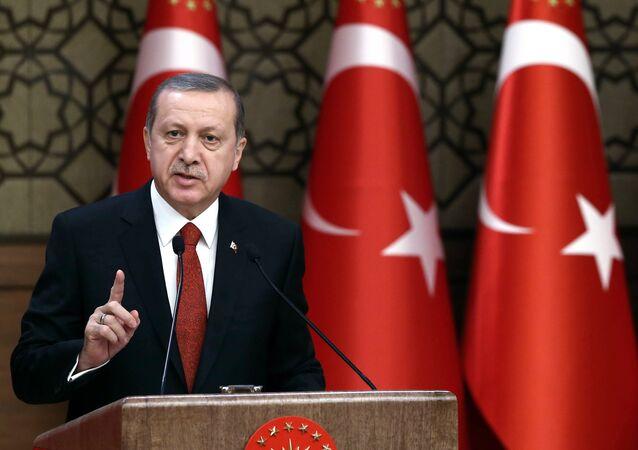 Turkey's President Recep Tayyip Erdogan addresses a meeting in Ankara, Turkey, Thursday, Dec. 3, 2015