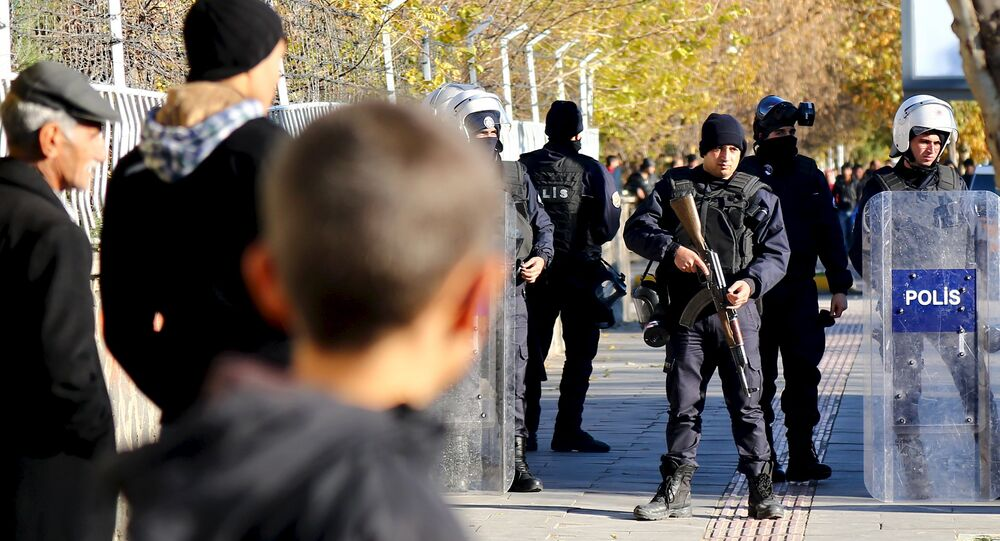 Turkish riot police stand guard during a protest against the curfew in Sur district in the Kurdish dominated southeastern city of Diyarbakir, Turkey, December 6, 2015