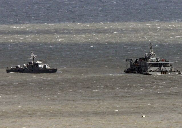 South Korea's navy ships patrol near Yeonpyeong Island, South Korea, Wednesday, Nov. 23, 2011. File photo