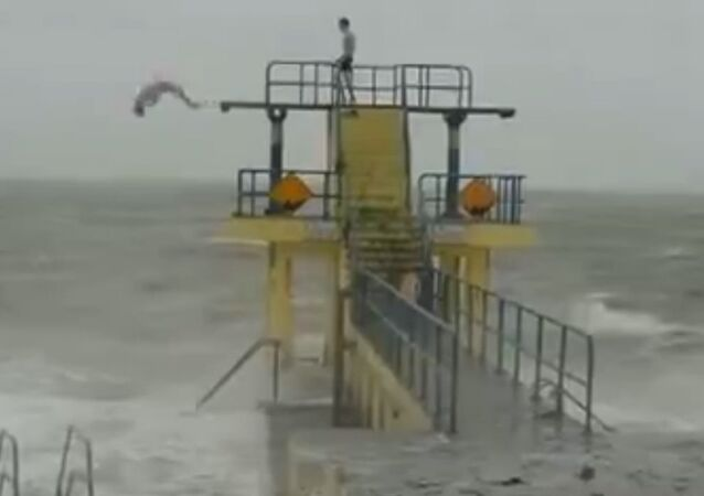 Youths Slammed for Diving Into Choppy Waters Amid Storm Conditions