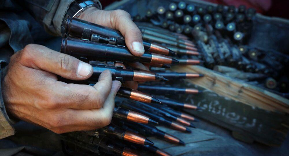 A fighter prepares an ammunition belt.