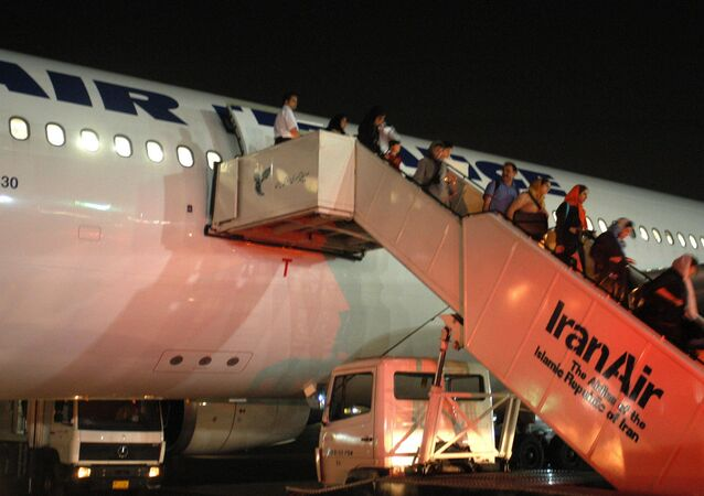 Passengers of Paris-Tehran flight of Air France take the stairs down to Tehran's Mehrabad airport (File)