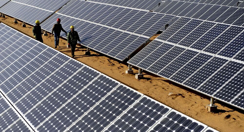 Workers check solar panels