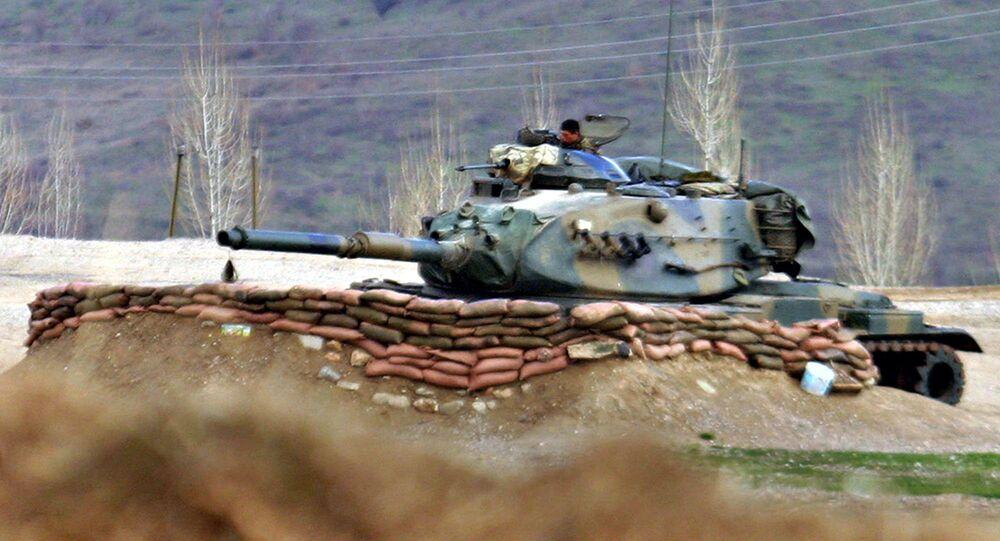Turkish Army tank stands ready near the village of Bamarni in northern Iraq, 30km beyond the Turkey-Iraq border