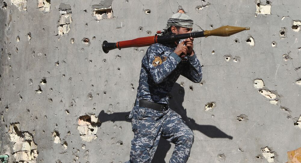 Iraqi security forces member takes combat position as he carries a Rocket Propelled Grenade (RPG) in the rural town of Husayba, in the Euphrates Valley seven kilometres (4.5 miles) east of Ramadi, on December 7, 2015