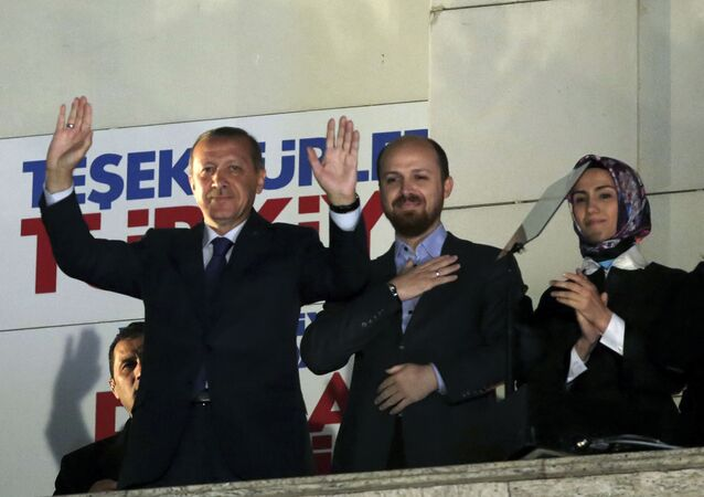 Turkey's Prime Minister Recep Tayyip Erdogan, his son Bilal Erdogan and daughter Sumeyye Erdogan salute supporters from the balcony of his ruling party headquarters in Ankara.