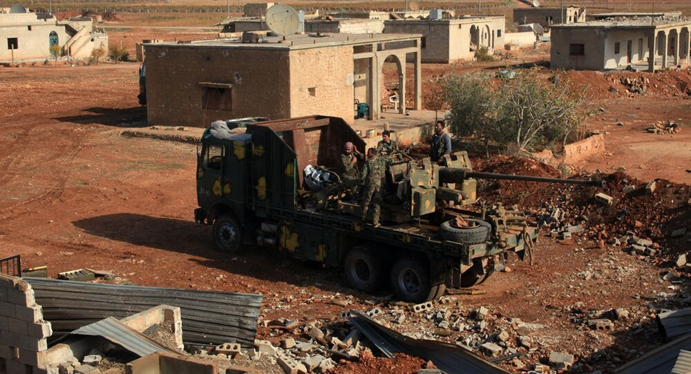 Syrian government fighters stand on a vehicle carrying heavy artillery  in the village of Akoula near the airport of Kweyris, in the northern Syrian province of Aleppo, after they re-took the area from the control of the Islamic State (IS) group (File)