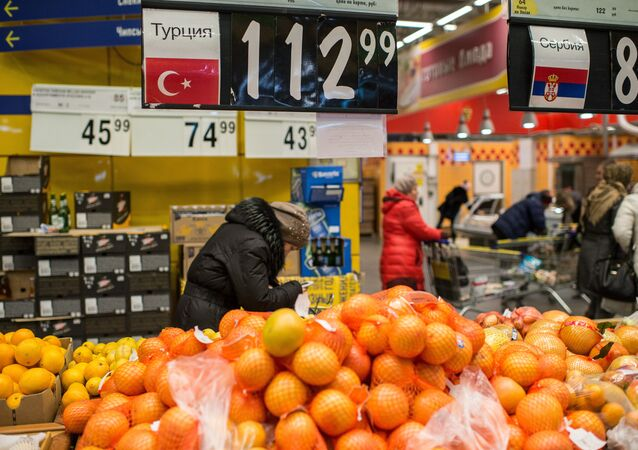 People buy Turkish fruit in a supermarket in Omsk, Russia