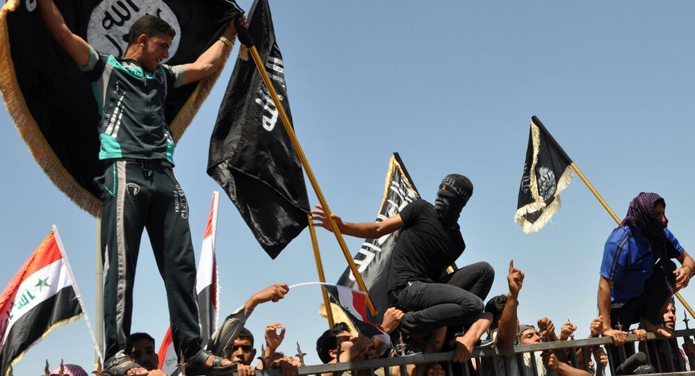 FILE - Masked Sunni protesters wave Islamist flags while others chant slogans at an anti-government rally in Fallujah, Iraq