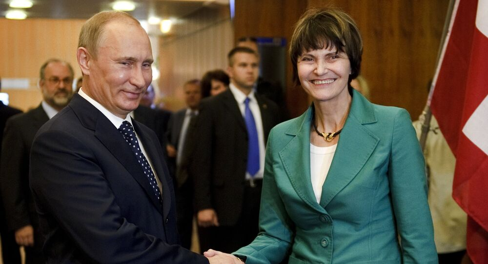 Russian Prime Minister Vladimir Putin (L) shakes hands to Swiss President Micheline Calmy-Rey prior to bilateral talks on the sideline of the 100th annual conference of the International Labor Organization (ILO) at the United Nations Offices on June 15, 2011 in Geneva