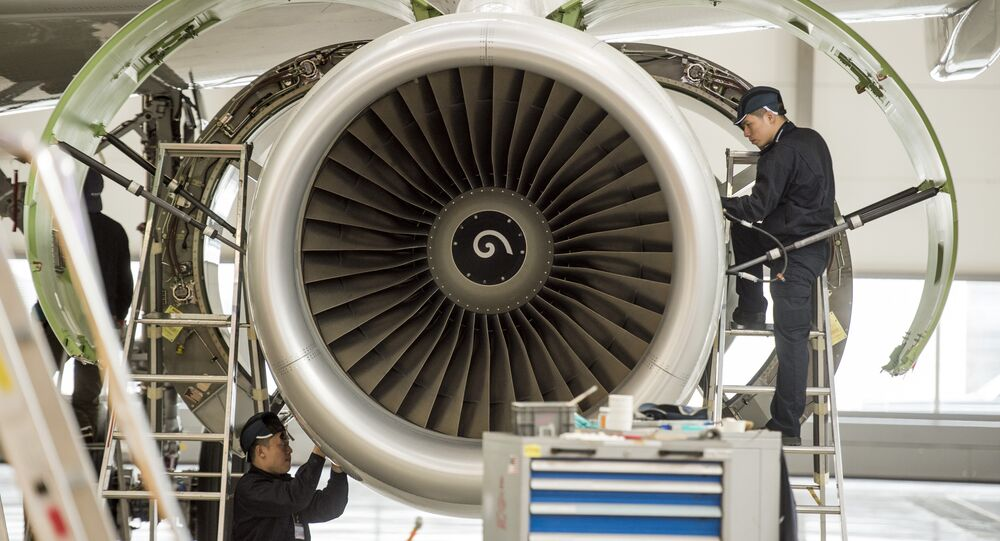 Chinese labourers work at the distribution chain for jet engines at the Airbus factory in Tianjin (File)