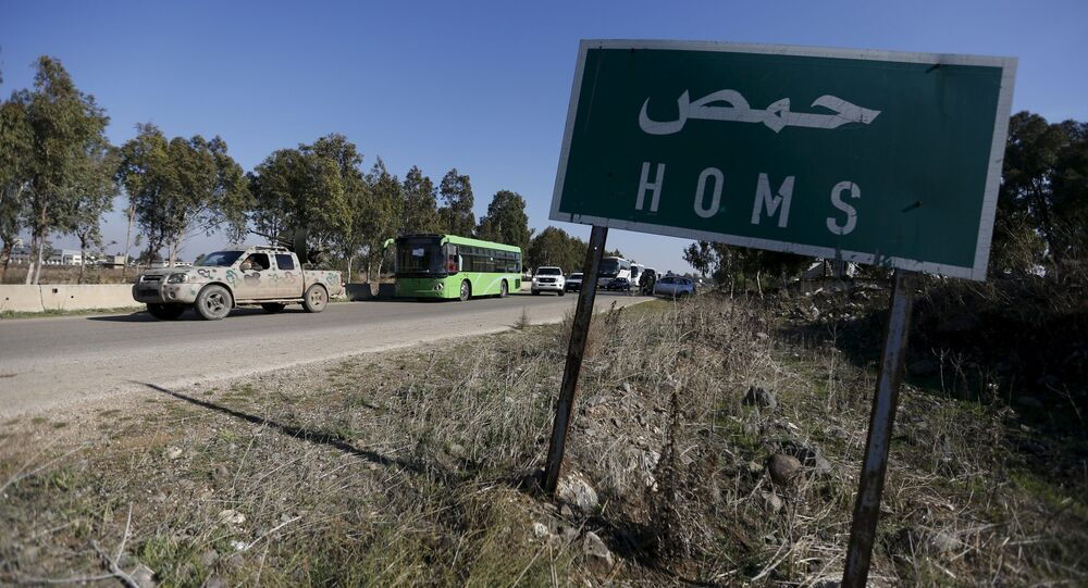 Buses leave district of Waer during a truce between the government and rebels, in Homs, Syria December 9, 2015