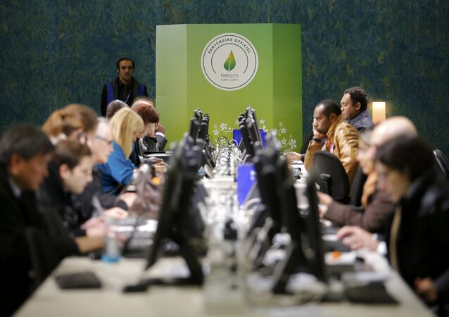 Participants works at computers during the World Climate Change Conference 2015 (COP21) at Le Bourget, near Paris, France, December 9, 2015