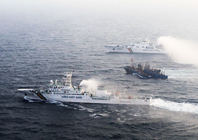 A picture taken on December 21 from a South Korean helicopter shows 12 Chinese fishing boats (C) banded together with ropes to thwart an attempt by South Korean coastguard ships to stop their alleged illegal fishing in the Yellow Sea off the coast of South Korea