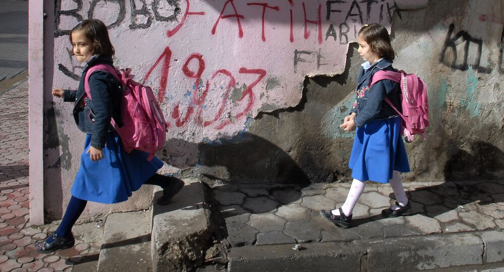 Turkish girls walk home from school in the Muslim quarter in Cizre, a district of Sirnak province, 13 November 2007, near the Turkish-Iraqi border, south-eastern Turkey.