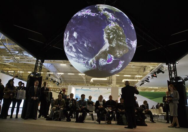 Participants attend a panel entitleScience on a Sphere Presentationat the COP21, United Nations Climate Change Conference, in Le Bourget, north of Paris, Tuesday, Dec. 8, 2015