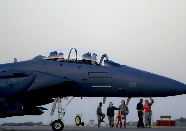 In this image released by the US Air Force (USAF), an F-15E Strike Eagle prepares to depart RAF Lakenheath in the United Kingdom to support Operation Inherent Resolve, on November 12, 2015