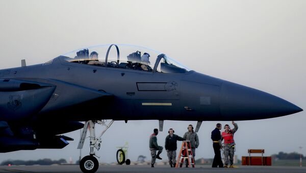 In this image released by the US Air Force (USAF), an F-15E Strike Eagle prepares to depart RAF Lakenheath in the United Kingdom to support Operation Inherent Resolve, on November 12, 2015 - Sputnik International