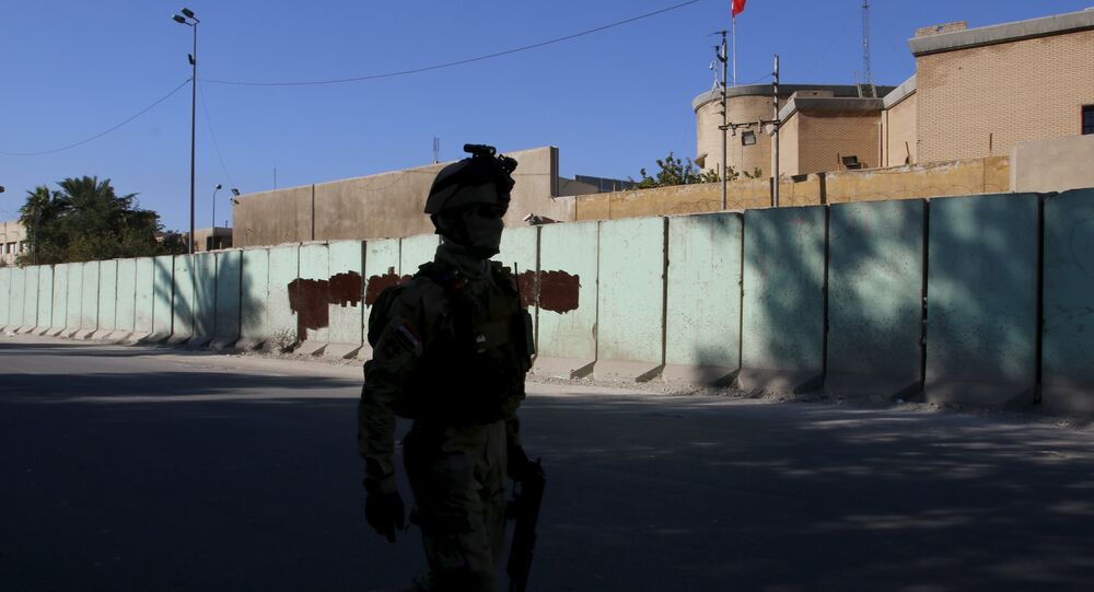 A member from Iraqi security forces walks past the Turkish embassy in Baghdad December 8 2015
