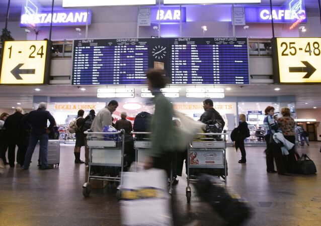 Passengers wait for their flights