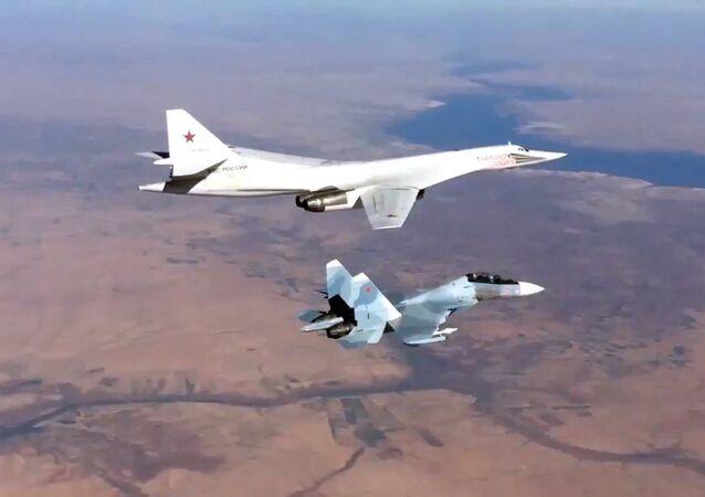 Russian Aerospace Defense Forces' Su-30SM fighter escorts a Tu-160 bomber