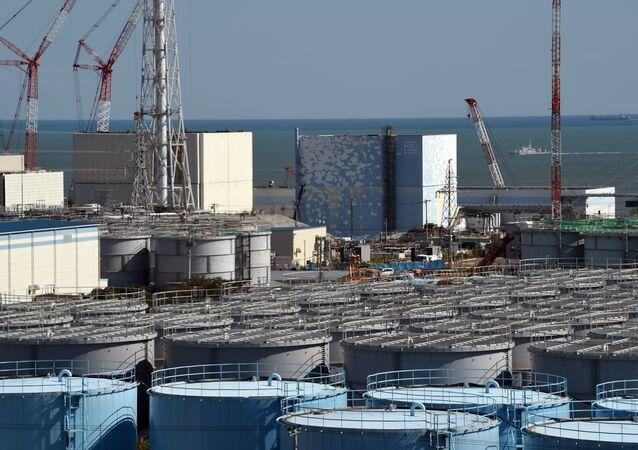 A coast guard vessel (back R) patrols the waters off the Fukushima Daiichi nuclear power plant in Okuma, Fukushima prefecture on October 9, 2015.