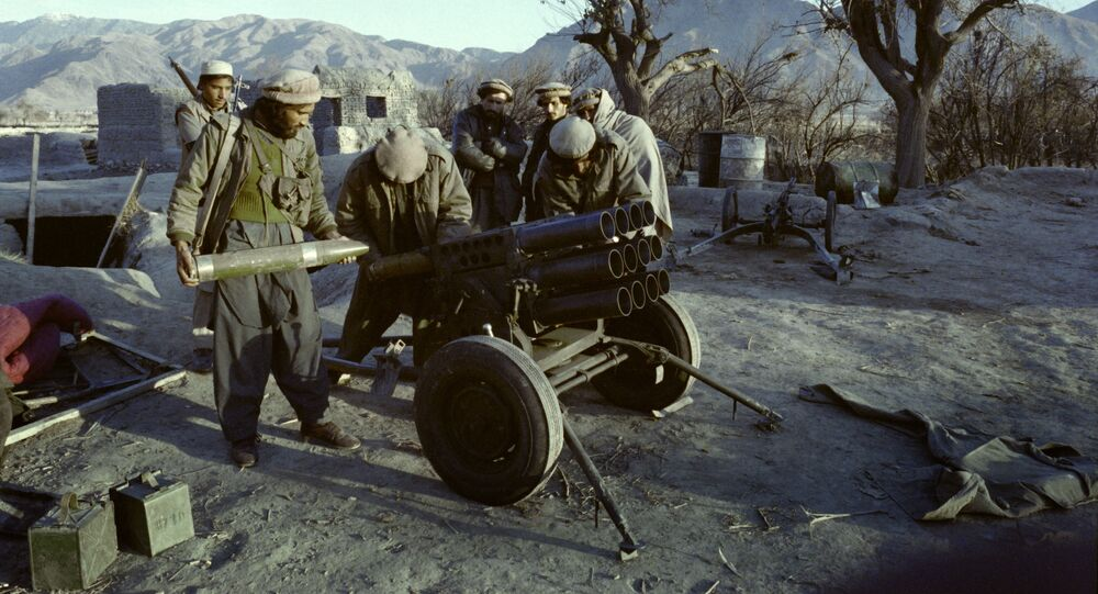 Afghan mujahideen prepare a rocket attack on the government troops in Shaga, Eastern Nangarhar province, on January 15, 1989 during the Afghan Civil War opposing the Islamic Unity of Afghanistan Mujahideen and the Democratic Republic of Afghanistan (DRA) supported by Soviet Union