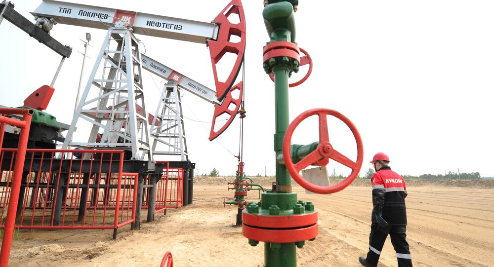 Staff worker of Lukoil company at a pumping cluster in the Pokachi city area of Russia's Khanty-Mansiysk Autonomous Okrug