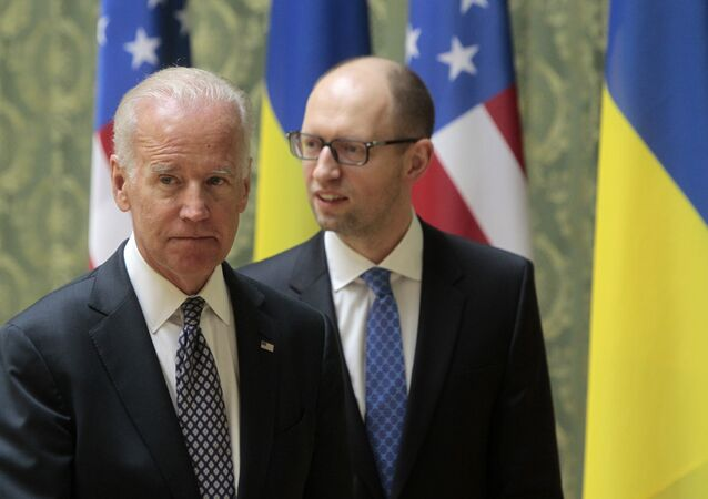 US Vice President Joe Biden, left, and Ukrainian Prime Minister Arseniy Yatsenyuk leave after delivering a joint statement to the press in Kiev, Ukraine, Tuesday, April 22, 2014.