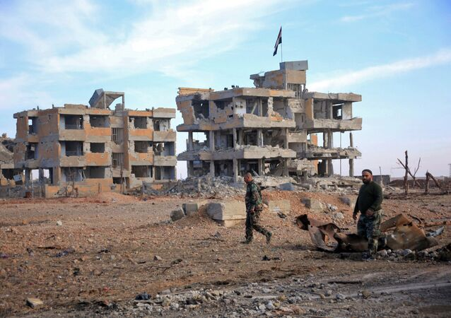 Syrian army soldiers patrol the countryside of Deir Hafer, a former bastion of Daesh, near the northern Syrian city of Aleppo on December 2, 2015.