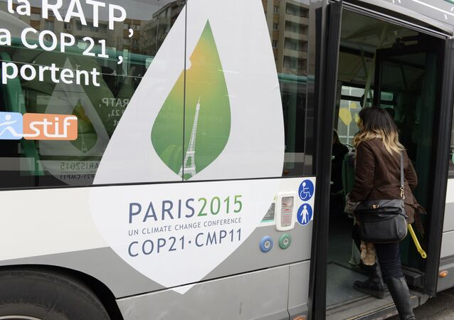 Passengers board a shuttle bus to the COP21 climate summit venue at Le Bourget, northeast of Paris on November 29, 2015