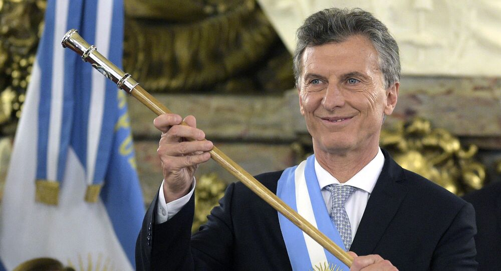 Argentine President Mauricio Macri, already wearing the presidential sash and staff, poses during his inauguration at the Casa Rosada government palace in Buenos Aires on December 10, 2015