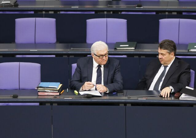 German Vice Chancellor and Economy Minister Sigmar Gabriel, right, talks with Foreign Minister Frank-Walter Steinmeier prior to the session of the parliament Bundestag in Berlin, Germany, Thursday, March 26, 2015