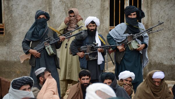 In this Tuesday, Nov. 3, 2015 photo, Afghan Taliban militants listen to Mullah Mohammed Rasool, unseen, the newly-elected leader of a breakaway faction of the Taliban, in Farah province, Afghanistan - Sputnik International