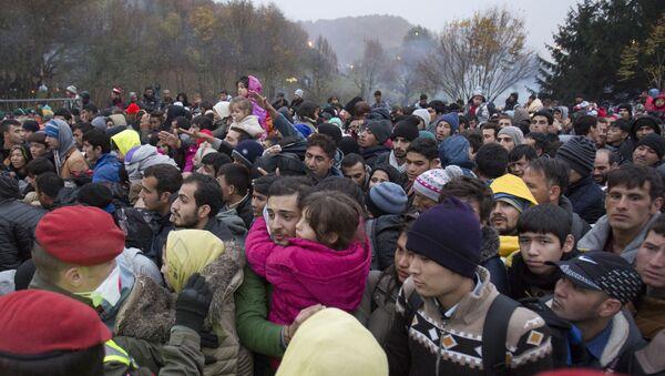 A file photo of migrants cue to enter Austria in Sentilj, Slovenia, Thursday, Oct. 29, 2015. - Sputnik International