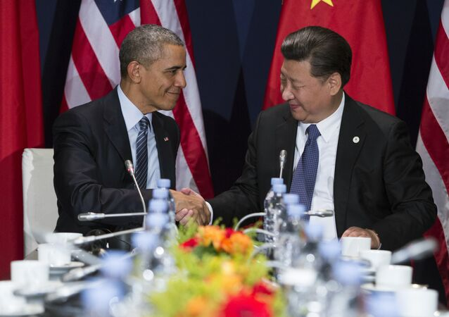 U.S. President Barack Obama, left, shakes hands with Chinese President Xi Jinping during their meeting held on the sidelines of the COP21, United Nations Climate Change Conference, in Le Bourget, outside Paris, Monday, Nov. 30, 2015