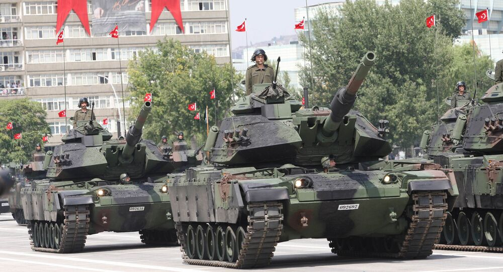 Turkish army tanks and aircrafts take part in a parade marking the 91st anniversary of Victory Day in Ankara on August 30, 2013