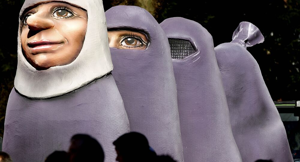 A carnival float depicting women wearing a burka is one part of the traditional carnival Rosemonday Parade in Duesseldorf, Germany, Monday, March 7, 2011.