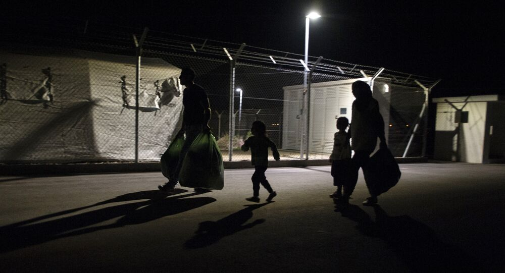 Migrants, who had applied for asylum in Cyprus, arrive with their belongings at Kokkinotrimithia refugee camp, west of the capital Nicosia, on November 19, 2015, after being transferred from Dhekelia by Cypriot authorities